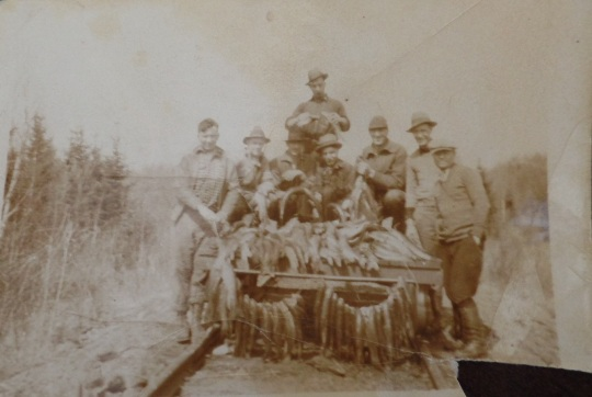 Great Grandpa Loney with fishing buddies and the fruits of their labor.